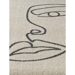 Teppich mit Gesichter-Motiv