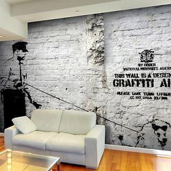 Fototapete Banksy - Graffiti Area schwarz/weiß Gr. 100 x 70