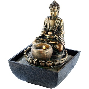 Beleuchteter Zimmerbrunnen mit Buddha